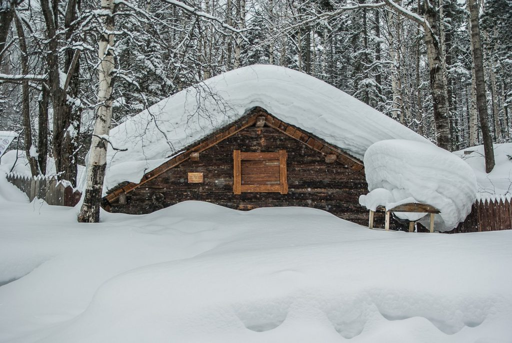 house with a dam of snow