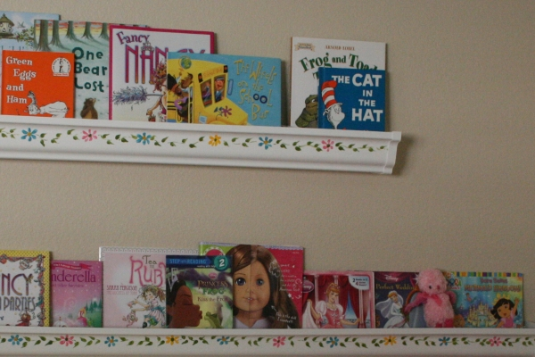 books in the shelving using the rain gutter ideas