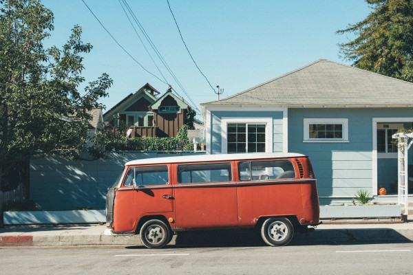red van in front of house with roofing shingles
