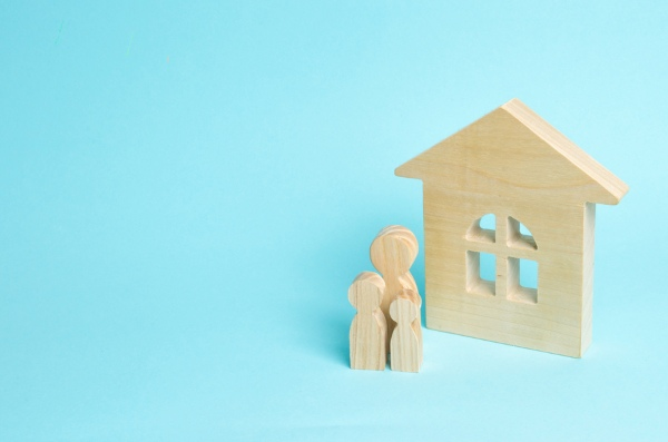 wooden shapes of house and family