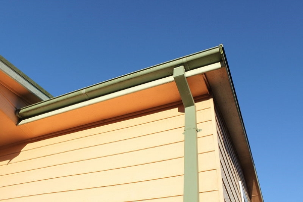 a modern half round gutter system with a sturdy downspout