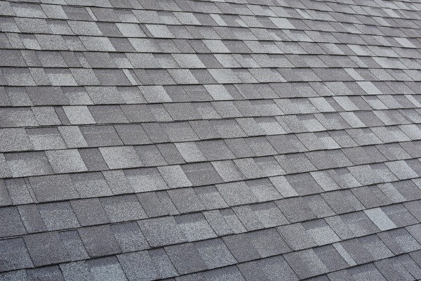 close up of grey dimensional asphalt shingles