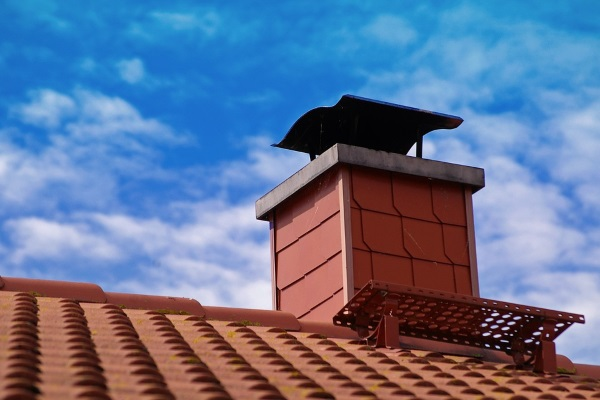 a chimney with roof flashing