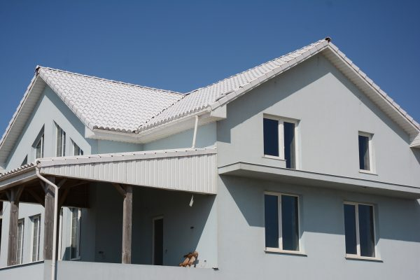 House with white tiled roof for energy saving.